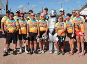 The 2015 Powering the Plains bike team with their mascot, Power.